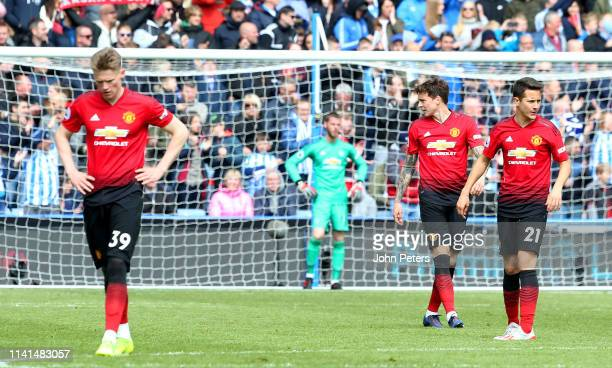 Ander Herrera of Manchester United and his teammates react after Huddersfield's equalising goal during the Premier League match between Huddersfield...