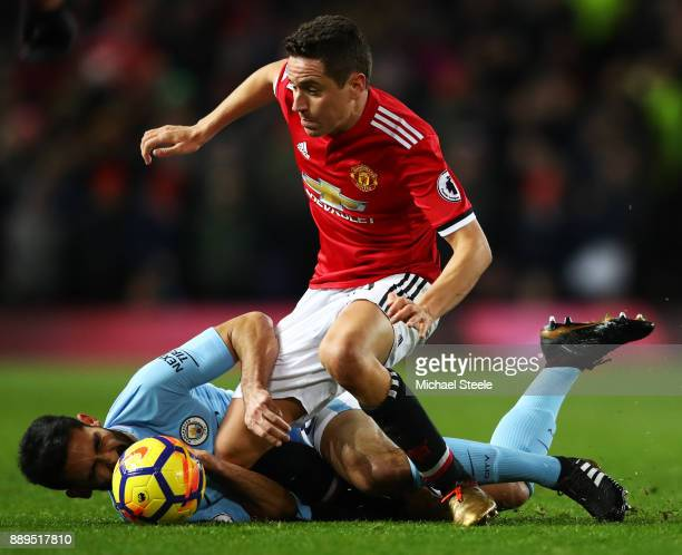 Ander Herrera of Manchester United and Ilkay Gundogan of Manchester City clash during the Premier League match between Manchester United and...