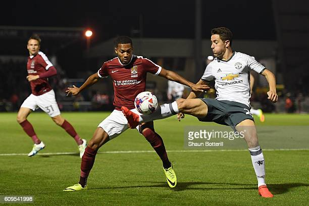 Ander Herrera of Manchester United and Kenji Gorre of Northampton Town in action during the EFL Cup Third Round match between Northampton Town and...