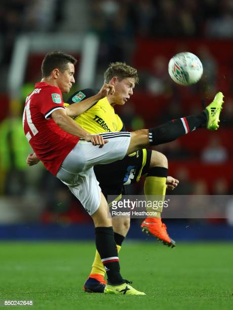 Ander Herrera of Manchester United and Matthew Palmer of Burton Albion battle for possession during the Carabao Cup Third Round match between...