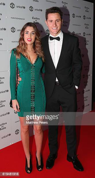Ander Herrera of Manchester United arrives with his partner at the annual United for UNICEF dinner at Old Trafford on October 31 2016 in Manchester...