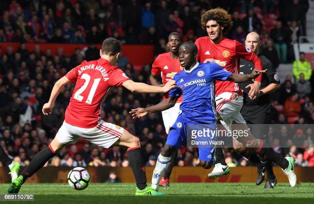 Ander Herrera of Manchester United attempts to stop N'Golo Kante of Chelsea during the Premier League match between Manchester United and Chelsea at...