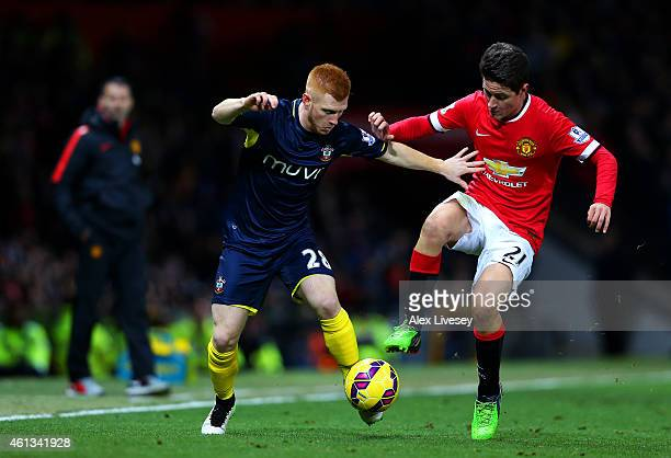 Ander Herrera of Manchester United battles for the ball with Harrison Reed of Southampton during the Barclays Premier League match between Manchester...