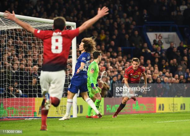 Ander Herrera of Manchester United celebrates as he scores his team's first goal with Juan Mata during the FA Cup Fifth Round match between Chelsea...