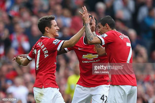 Ander Herrera of Manchester United celebrates scoring the second goal with team-mate Angel Di Maria during the Barclays Premier League match between...