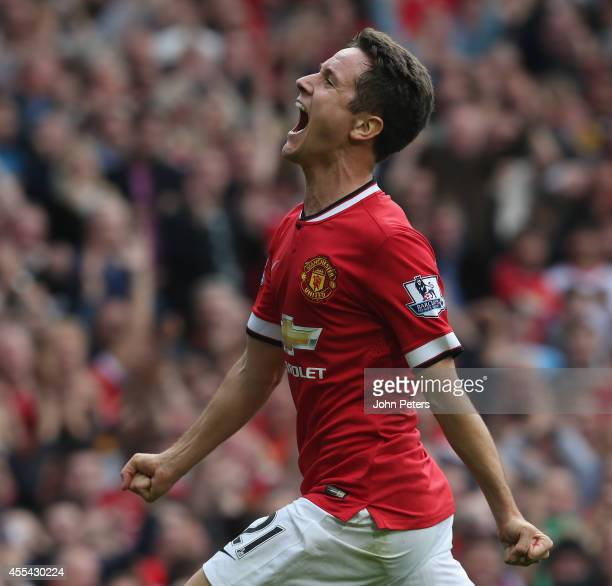 Ander Herrera of Manchester United celebrates scoring their second goal during the Barclays Premier League match between Manchester United and Queens...