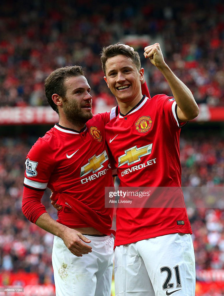 Ander Herrera of Manchester United celebrates with team-mate Juan Mata of Manchester United after scoring his team's third goal during the Barclays Premier League match between Manchester United and Aston Villa at Old Trafford on April 4, 2015 in Manchester, England.
