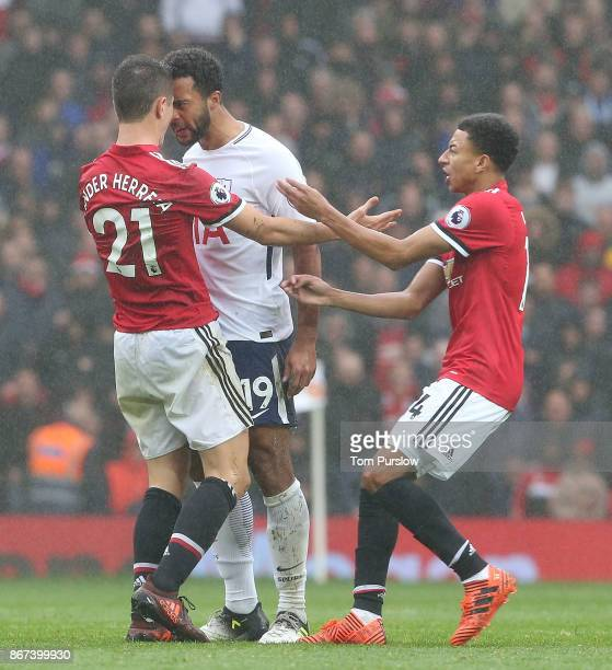 Ander Herrera of Manchester United clashes with Mousa Dembele of Tottenham Hotspur during the Premier League match between Manchester United and...