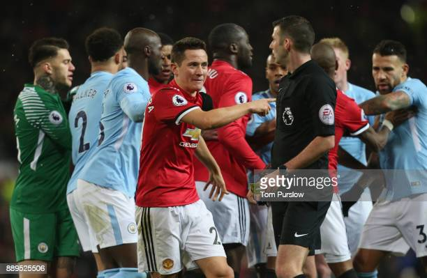 Ander Herrera of Manchester United clashes with Nicolas Otamendi of Manchester City during the Premier League match between Manchester United and...