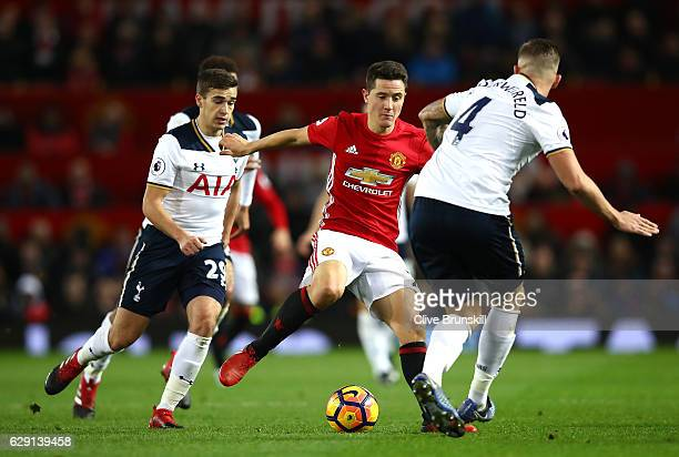 Ander Herrera of Manchester United competes for the ball against Harry Winks and Toby Alderweireld of Tottenham Hotspur during the Premier League...
