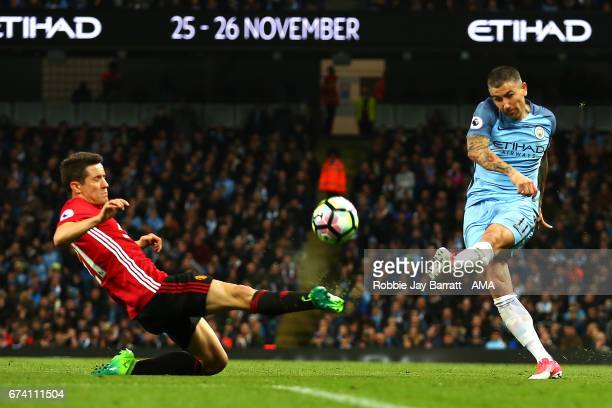 Ander Herrera of Manchester United competes with Aleksandar Kolarov of Manchester City during the Premier League match between Manchester City and...