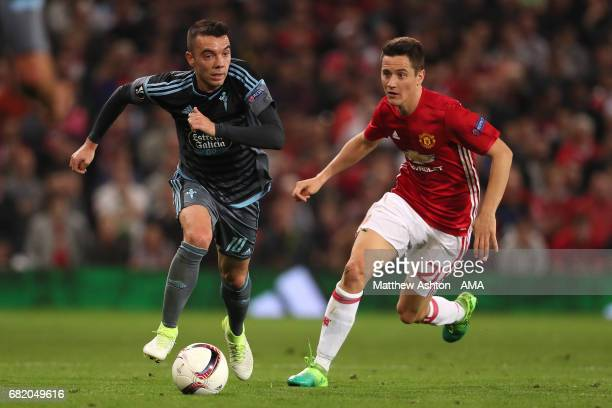 Ander Herrera of Manchester United competes with Iago Aspas of Celta Vigo during the UEFA Europa League semi final second leg match between...