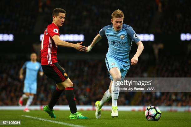 Ander Herrera of Manchester United competes with Kevin De Bruyne of Manchester City during the Premier League match between Manchester City and...