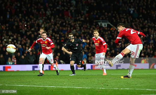 Ander Herrera of Manchester United converts the penalty to score his team's fourth goal during the UEFA Europa League Round of 32 second leg match...