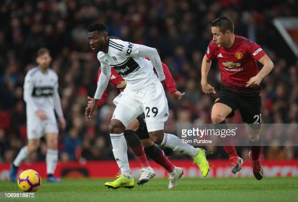 Ander Herrera of Manchester United in action with AndreFrank Zambo Anguissa of Fulham during the Premier League match between Manchester United and...