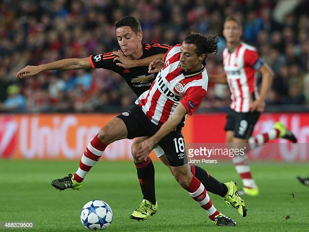Ander Herrera of Manchester United in action with Andres Guardado of PSV Eindhoven during the UEFA Champions League match between PSV Eindhoven and...
