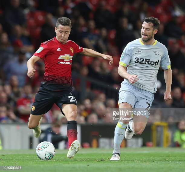 Ander Herrera of Manchester United in action with David Nugent of Derby County during the Carabao Cup Third Round match between Manchester United and...