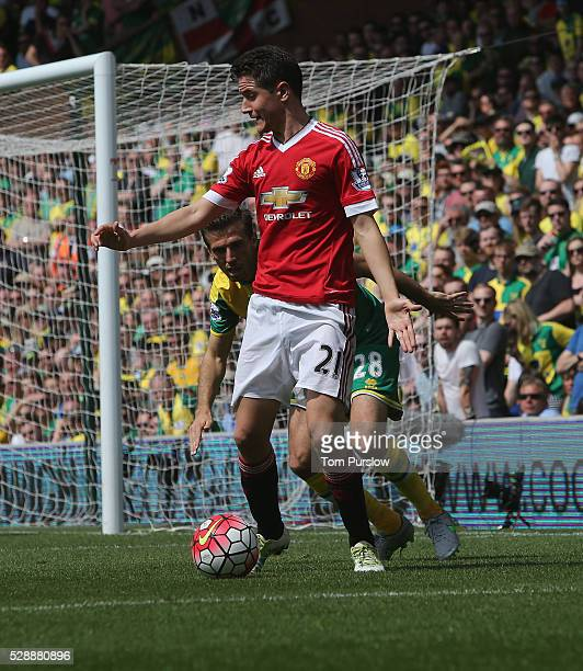 Ander Herrera of Manchester United in action with Gary O'Neil of Norwich City during the Barclays Premier League match between Norwich City and...