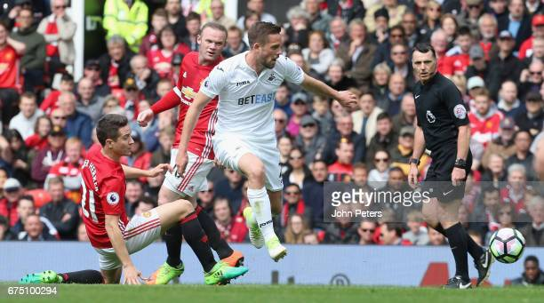 Ander Herrera of Manchester United in action with Gylfi Sigurdsson of Swansea City during the Premier League match between Manchester United and...