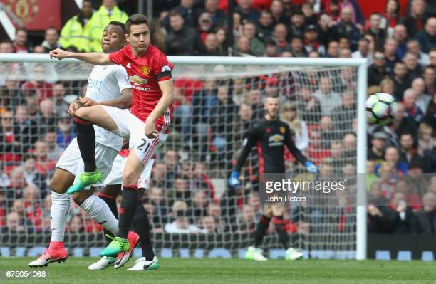 Ander Herrera of Manchester United in action with Jordan Ayew of Swansea City during the Premier League match between Manchester United and Swansea...