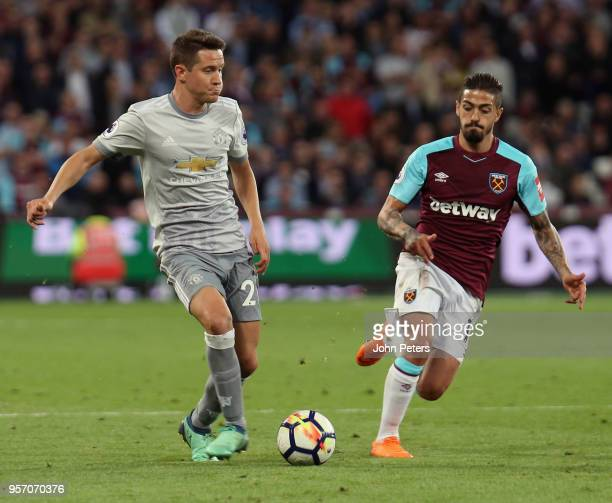 Ander Herrera of Manchester United in action with Manuel Lanzini of West Ham United during the Premier League match between West Ham United and...