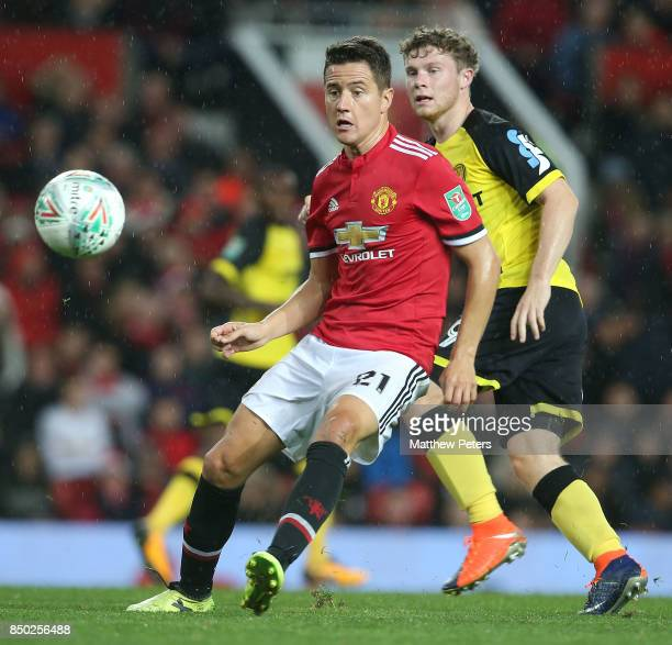Ander Herrera of Manchester United in action with Matthew Palmer of Burton Albion during the Carabao Cup Third Round between Manchester United and...