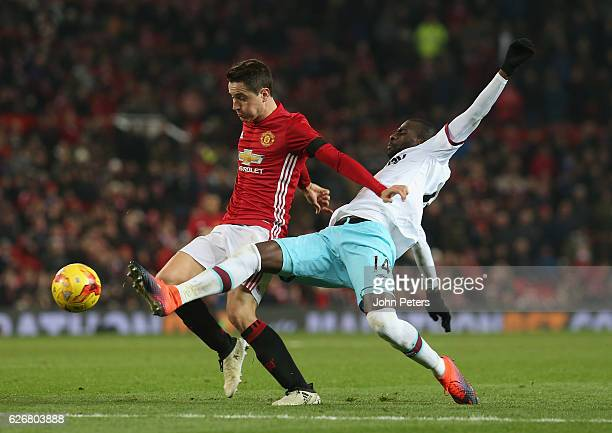 Ander Herrera of Manchester United in action with Pedro Obiang of West Ham United during the EFL Cup QuarterFinal match between Manchester United and...