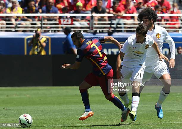 Ander Herrera of Manchester United in action with Pedro of Barcelona during the International Champions Cup 2015 match between Manchester United and...