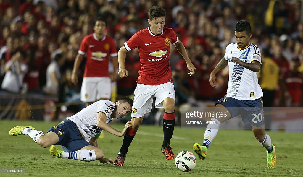 Ander Herrera of Manchester United in action with Robbie Keane (L) and A.J. Delagarza of Los Angeles Galaxy during the pre-season friendly match between LA Galaxy and Manchester United at Rose Bowl on July 23, 2014 in Pasadena, California.