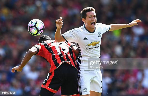 Ander Herrera of Manchester United is challenged by Callum Wilson of AFC Bournemouth during the Premier League match between AFC Bournemouth and...