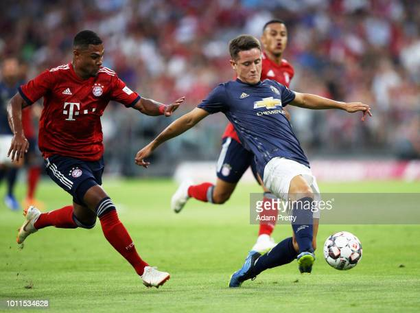 Ander Herrera of Manchester United is challenged by Serge Gnabry of Bayern Munich during the Bayern Muenchen v Manchester United Friendly Match at...
