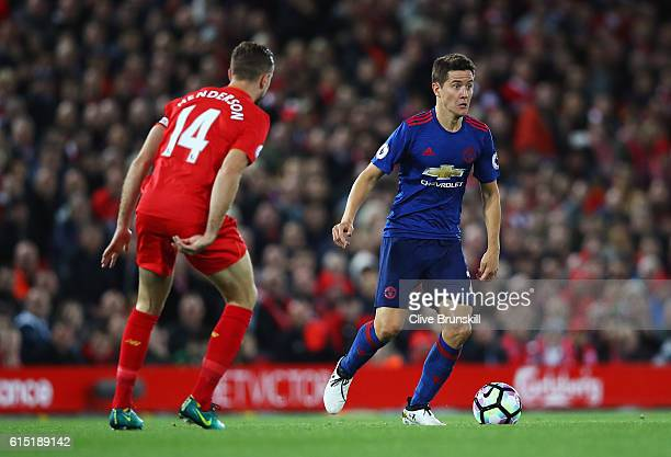 Ander Herrera of Manchester United is closed down by Jordan Henderson of Liverpool during the Premier League match between Liverpool and Manchester...