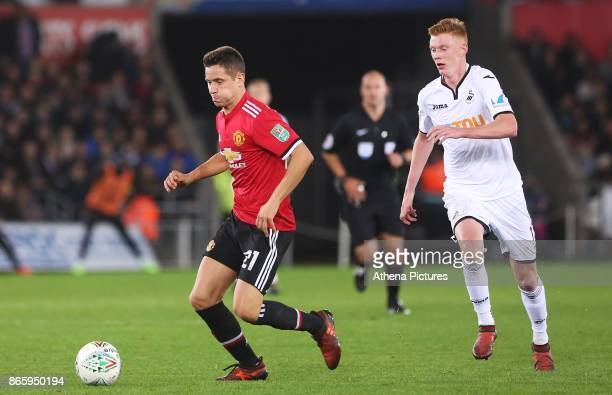Ander Herrera of Manchester United is marked by Sam Clucas of Swansea City during the Carabao Cup Fourth Round match between Swansea City and...