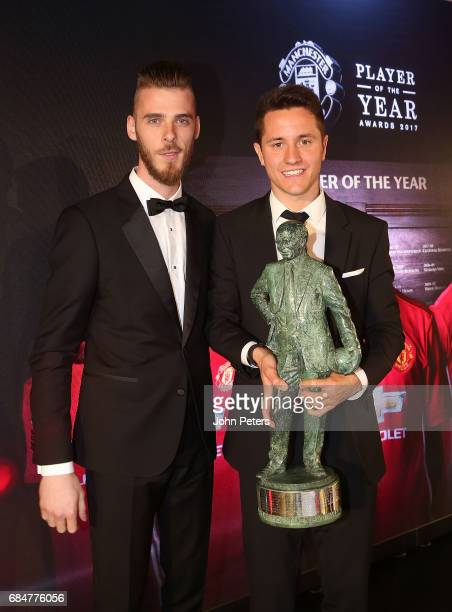 Ander Herrera of Manchester United is presented with the Sir Matt Busby Player of the Year award by David de Gea at the club's annual Player of the...
