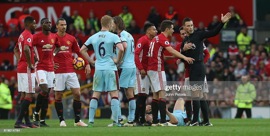 Ander Herrera of Manchester United is sent off by referee Mark Clattenburg during the Premier League match between Manchester United and Burnley at Old Trafford on October 29, 2016 in Manchester, England.