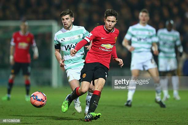Ander Herrera of Manchester United is tracked by Joseph Edwards of Yeovil Town during the FA Cup Third Round match between Yeovil Town and Manchester...