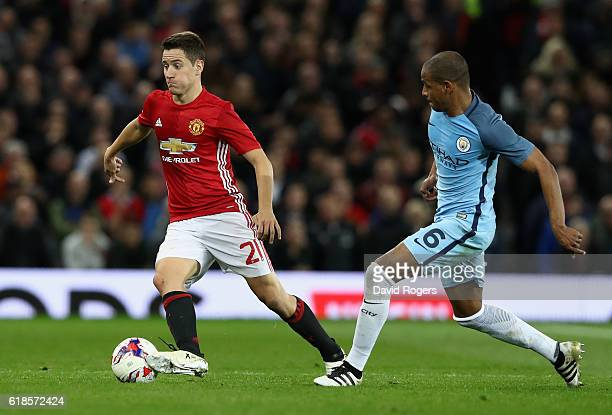 Ander Herrera of Manchester United moves away from Fernando during the EFL Cup Fourth Round match between Manchester United and Manchester City at...