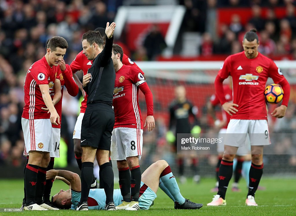 Ander Herrera of Manchester United protests to referee Mark Clattenburg (2nd R) after the red card during the Premier League match between Manchester United and Burnley at Old Trafford on October 29, 2016 in Manchester, England.