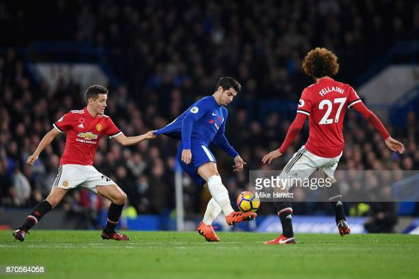 Ander Herrera of Manchester United pulls Alvaro Morata of Chelsea shirt during the Premier League match between Chelsea and Manchester United at...