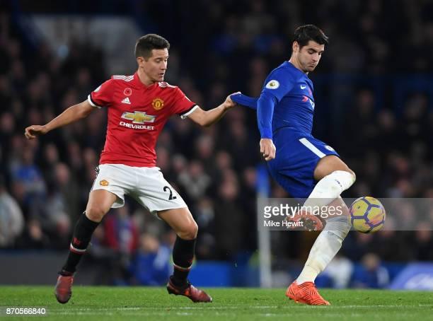Ander Herrera of Manchester United pulls Alvaro Morata of Chelsea shirt during the Premier League match between Chelsea and Manchester United at...