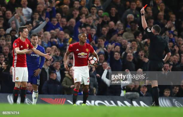 Ander Herrera of Manchester United reacts as he is shown a red card by referee Michael Oliver and is sent off during The Emirates FA Cup QuarterFinal...