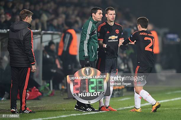 Ander Herrera of Manchester United replaces Morgan Schneiderlin during the UEFA Europa League round of 32 first leg match between FC Midtjylland and...