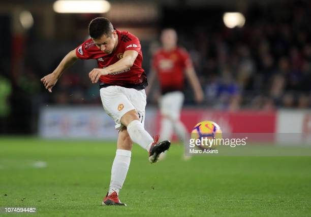 Ander Herrera of Manchester United scores his team's second goal during the Premier League match between Cardiff City and Manchester United at...