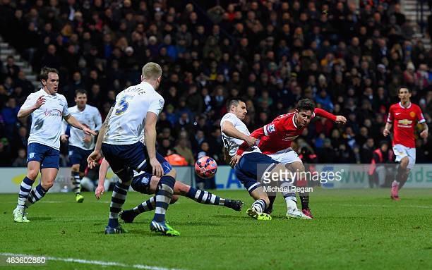 Ander Herrera of Manchester United scores their first goal under pressure from Bailey Wright of Preston North End during the FA Cup Fifth round match...