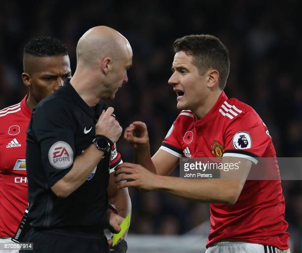 Ander Herrera of Manchester United speaks to Referee Anthony Taylor during the Premier League match between Chelsea and Manchester United at Stamford...