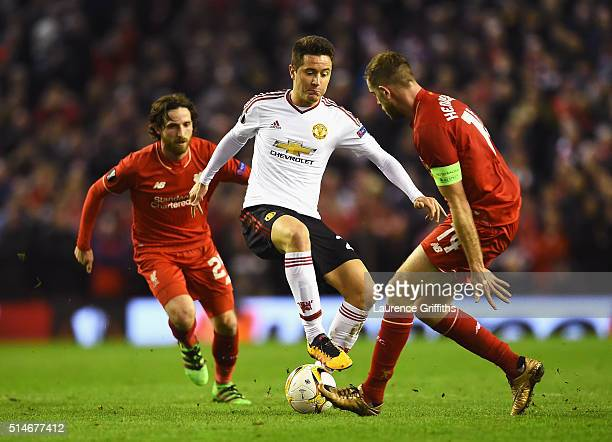 Ander Herrera of Manchester United takes on Joe Allen and Jordan Henderson of Liverpool during the UEFA Europa League Round of 16 first leg match...