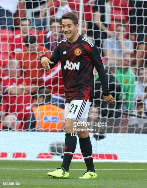 Ander Herrera of Manchester United warms up ahead of the Premier League match between Manchester United and Leicester City at Old Trafford on August...
