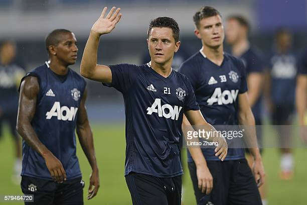 Ander Herrera of Manchester United waves to fans during the team training session for the 2016 International Champions Cup match between Manchester...