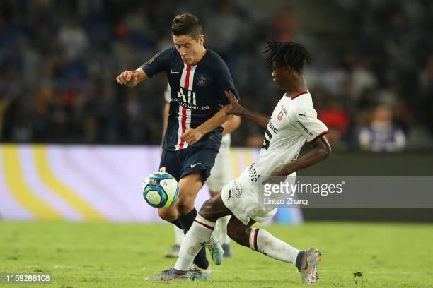 Ander Herrera of Paris SaintGermain competes the ball with Eduardo Camavinga of Stade Rennais FC during the 2019 Trophee des Champions between Paris...