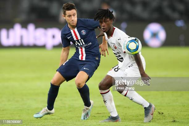 Ander Herrera of Paris Saint-Germain competes the ball with Eduardo Camavinga of Stade Rennais FC during to the 2019 Trophee des Champions between...